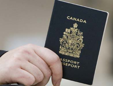 A passenger holds his Canadian passport before boarding a flight to the United States, at the Ottawa, Ont. airport on Tuesday Jan 23, 2007. Today is the first day that all passengers entering the United States via air must have a valid passport. (CP PHOTO/Tom Hanson) Canada